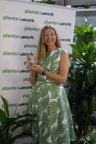 Madeleine Evans with the Gold Leaf Award trophy